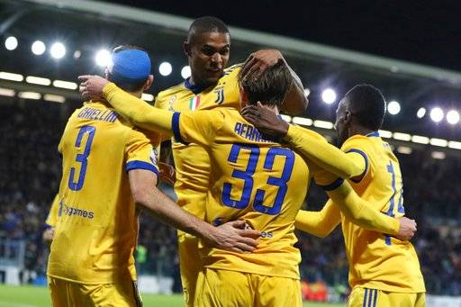 Juventus' Federico Bernardeschi, 2nd right, celebrates with teammates, from left, Giorgio Chiellini, Douglas Costa and Blaise Matuidi after scoring during the Serie A soccer match between Cagliari and Juventus in Cagliari, Italy, Saturday, Jan. 6, 2018. (Fabio Murru/ANSA via AP)