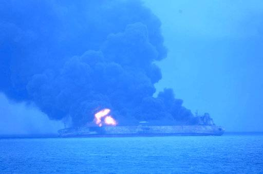 "In this photo provided by Korea Coast Guard, the Panama-registered tanker ""Sanchi"" is seen ablaze after a collision with a Hong Kong-registered freighter off China's eastern coast Sunday, Jan. 7, 2018. The oil tanker collided with a bulk freighter and caught fire off China's eastern coast, leaving its entire crew of 32 missing, most of them Iranians, authorities said. (Korea Coast Guard via AP)"