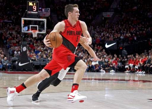 Portland Trail Blazers guard Pat Connaughton drives to the basket against the San Antonio Spurs during the first half of an NBA basketball game in Portland, Ore., Sunday, Jan. 7, 2018. (AP Photo/Craig Mitchelldyer)