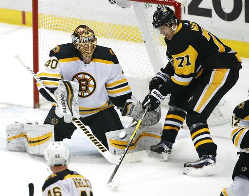 Pittsburgh Penguins' Evgeni Malkin (71) cannot get his stick on a rebound in front of Boston Bruins goaltender Tuukka Rask (40) during the first period of an NHL hockey game in Pittsburgh, Sunday, Jan. 7, 2018. (AP Photo/Gene J. Puskar)