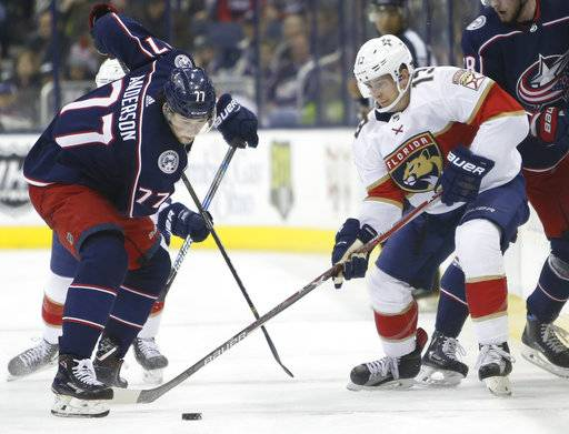 Columbus Blue Jackets' Josh Anderson, left, tries to take the puck away from Florida Panthers' Mark Pysyk during the second period of an NHL hockey game Sunday, Jan. 7, 2018, in Columbus, Ohio. (AP Photo/Jay LaPrete)