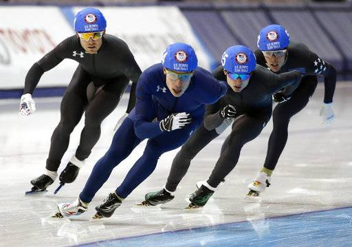 Brian Hansen leads the group of skaters as he competes in the men's mass start race during the U.S. Olympic long track speedskating trials, Sunday, Jan. 7, 2018, in Milwaukee. (AP Photo/John Locher)
