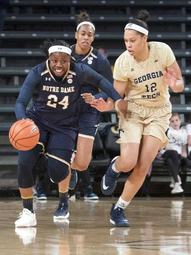 Notre Dame guard Arike Ogunbowale (24) tries to fend off Georgia Tech forward Breanna Brown (12) as she pushes the ball up the floor after a steal during the first half of an NCAA college basketball game Sunday, Jan. 7, 2018, in Atlanta. (AP Photo/John Amis)
