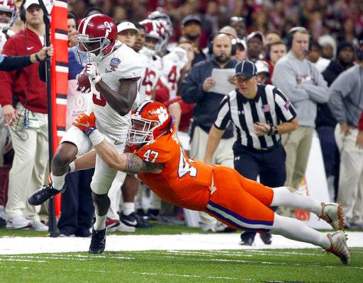 FILE - In this Monday, Jan. 1, 2018, file photo, Alabama wide receiver Calvin Ridley (3) is tackled by Clemson linebacker James Skalski (47) in the first half of the Sugar Bowl NCAA college football game in New Orleans. Ridley is a likely first-round NFL draft pick regarded as one of the nation's best at his position, but you might not have noticed watching the fourth-ranked Crimson Tide's last couple of games. Georgia's Javon Wims and Terry Godwin have yielded much of the spotlight to the Bulldogs heralded tailbacks also going into the Monday, Jan. 8, 2018, College Football national championship game. (AP Photo/Butch Dill, File)