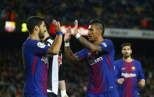 FC Barcelona's Paulinho, right, celebrates after scoring with his teammate Luis Suarez during the Spanish La Liga soccer match between FC Barcelona and Levante at the Camp Nou stadium in Barcelona, Spain, Sunday, Jan. 7, 2018. (AP Photo/Manu Fernandez)