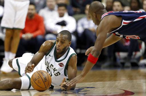 Milwaukee Bucks guard DeAndre Liggins, left, and Washington Wizards guard Jodie Meeks scramble for the ball during the second half of an NBA basketball game Saturday, Jan. 6, 2018, in Washington. The Bucks won 110-103. (AP Photo/Alex Brandon)