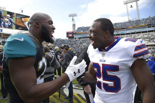 Jacksonville Jaguars running back Leonard Fournette, left, and Buffalo Bills running back LeSean McCoy (25) chat on the field before an NFL wild-card playoff football game, Sunday, Jan. 7, 2018, in Jacksonville, Fla. (AP Photo/Phelan M. Ebenhack)