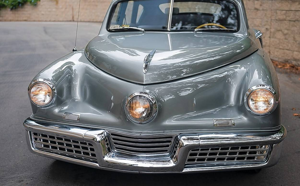 "The Tucker is best known for its ""cyclops eye,"" a third headlight that swiveled in conjunction with the front wheels as the car went around turns."