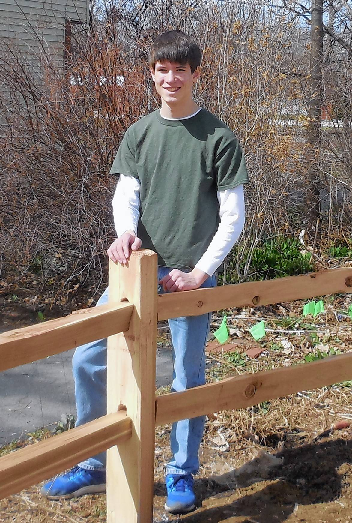 Christopher Bauer of Lombard Boy Scout Troop 202 recently was awarded the rank of Eagle for, among other things, his work to replace a split rail fence at the historic Sheldon Peck home.