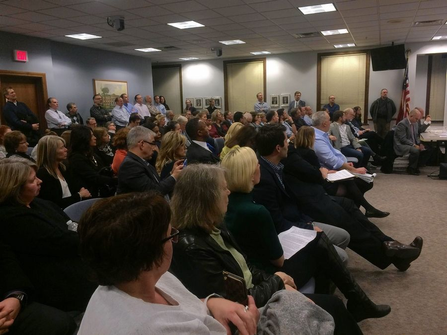 Roughly 100 people packed a Wheaton planning and zoning board meeting Tuesday night to voice concerns over a request by a Chicago nonprofit group to open a proposed drug and alcohol treatment center near a Danada shopping center.