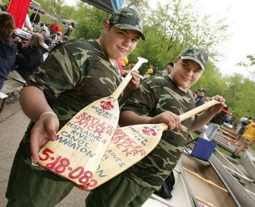 "Eagle Scouts at age 16, identical twins Skyler, left, and Spencer Nick of Wauconda show off the paddles they designed before taking on the Des Plaines River Canoe Marathon, which started in Libertyville. The brothers, now 25, are contestants in the Food Network's ""Worst Cooks in America."""