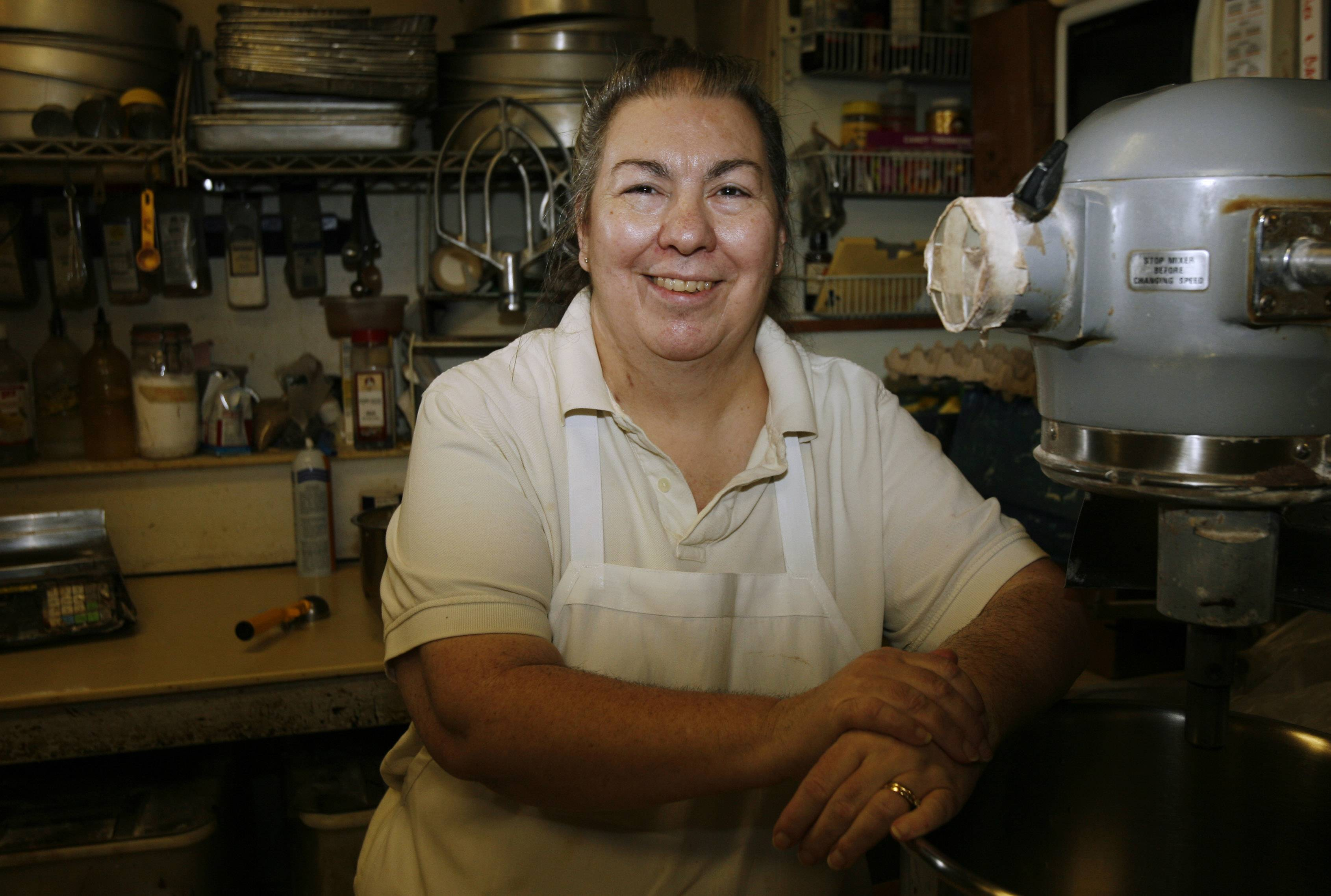 "Diane Ahrens is owner of Piece-A-Cake Bakery in East Dundee and the driving force behind Operation Sweettooth, which sends packages of cookies and treats to military men and women serving overseas. ""I never thought it would be going this long,"" she said."