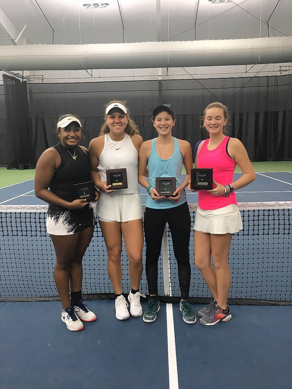Playing partners Ivana Corley (from left) and Glenbard East's Kolie Allen defeated Clarissa and Christina Hand on Jan. 2 in Orlando to capture the United States Tennis Association National Winter Championships Girls 18s doubles title.