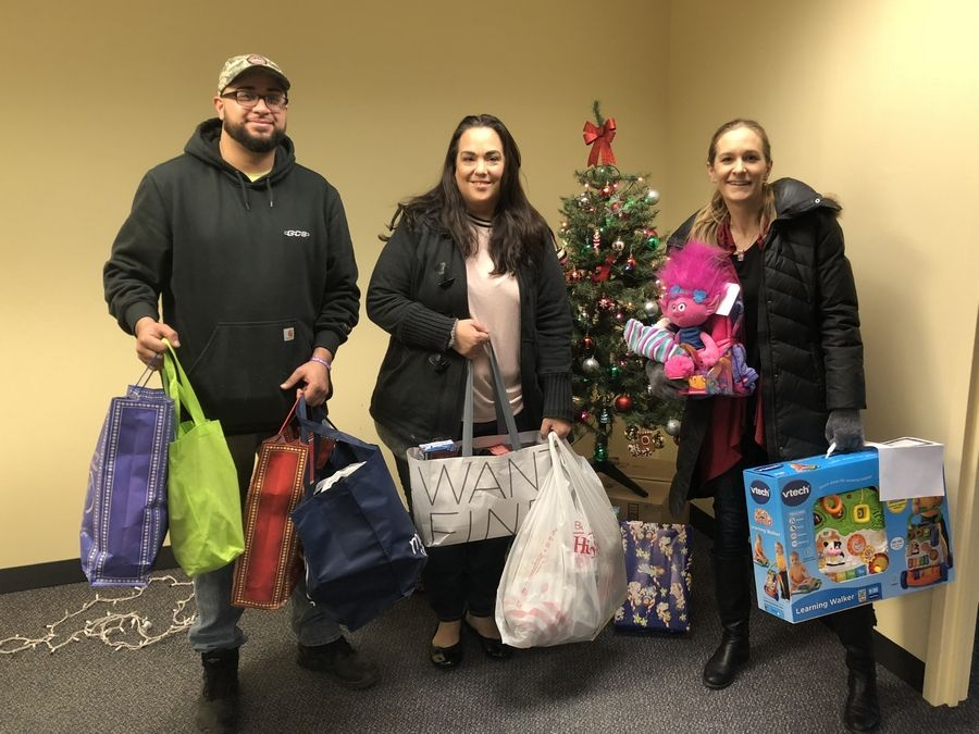 Employees from Power Construction LLC in Chicago donate toys for 50 children in ChildServ's early learning program.