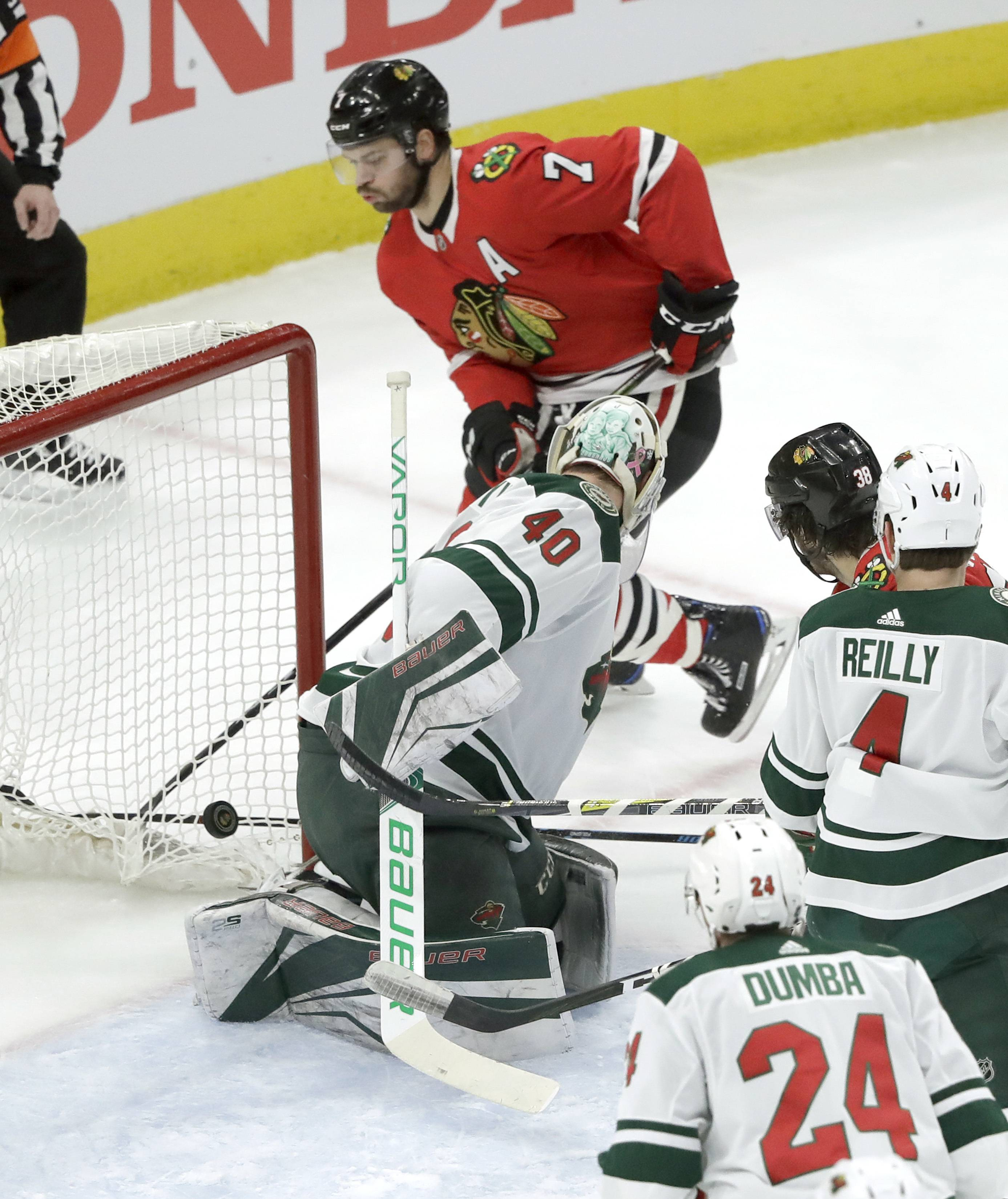 Blackhawks' Brent Seabrook (7) watches his shot score past Minnesota Wild goaltender Devan Dubnyk (40) during the first period on Wednesday, in Chicago.