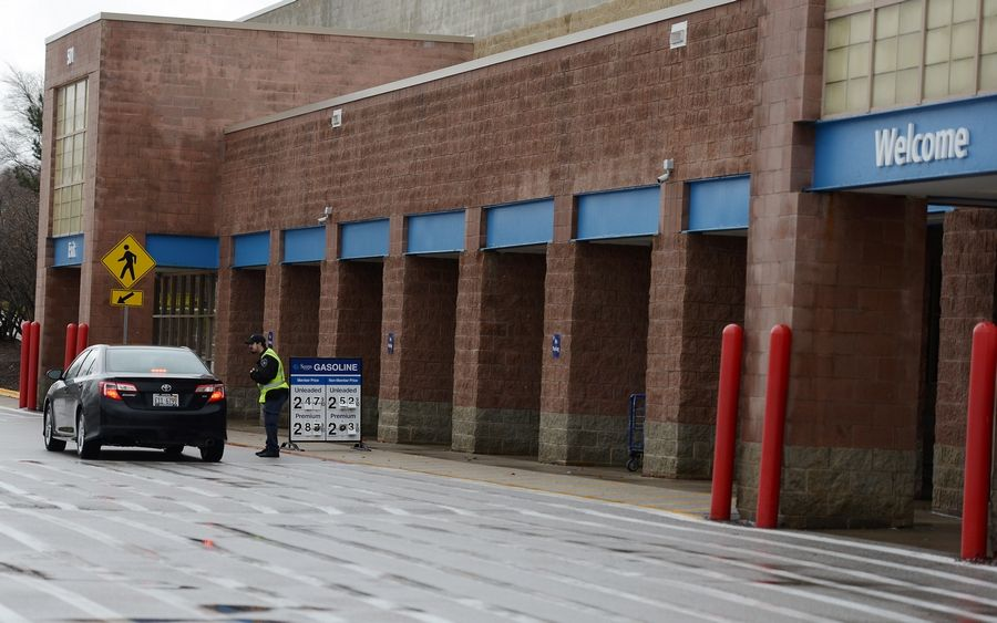 A security guard tells a customer that the Sam's Club in Batavia is closed Thursday.