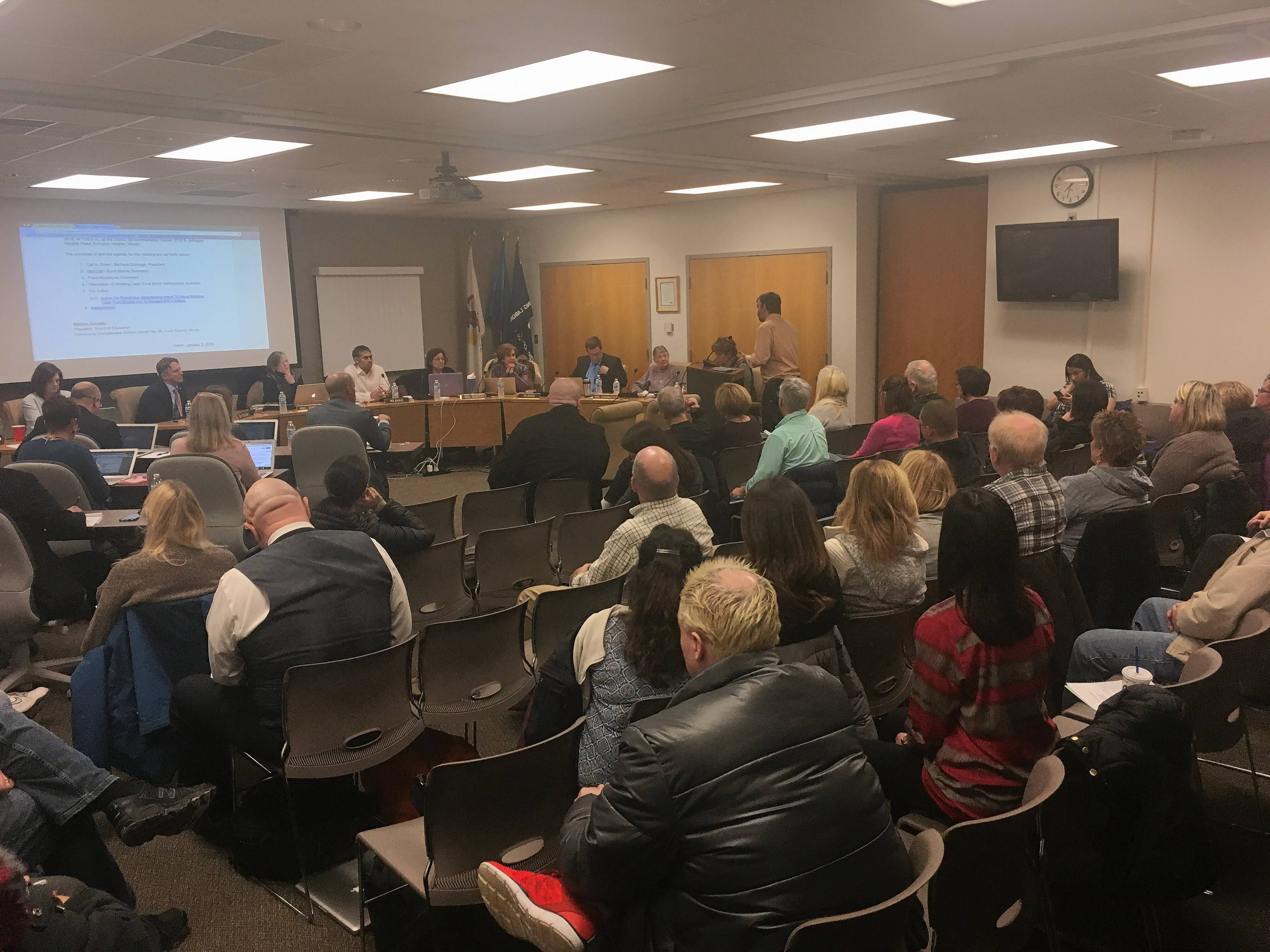 Elk Grove Township District 59 residents crowded a school board meeting Thursday as members decided to pull a bond issue referendum from the ballot.