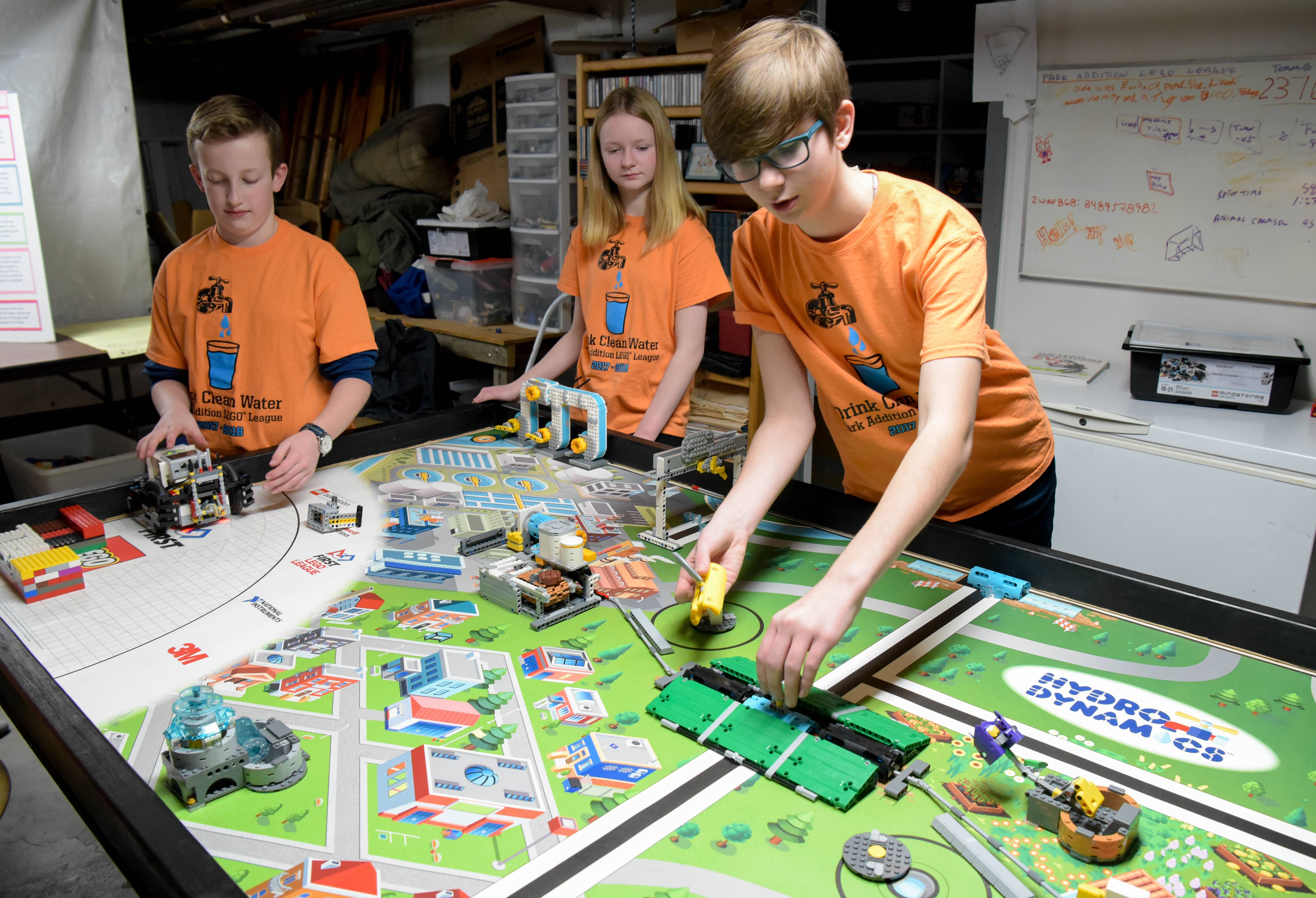 Park Addition Lego League team members Sam Aldrich, Sammy Davies and Katie Meyer explain obstacles on the board their robot will use to accomplish challenges Sunday during a state First Lego League competition in Elgin. See them in action at dailyherald.com/video.