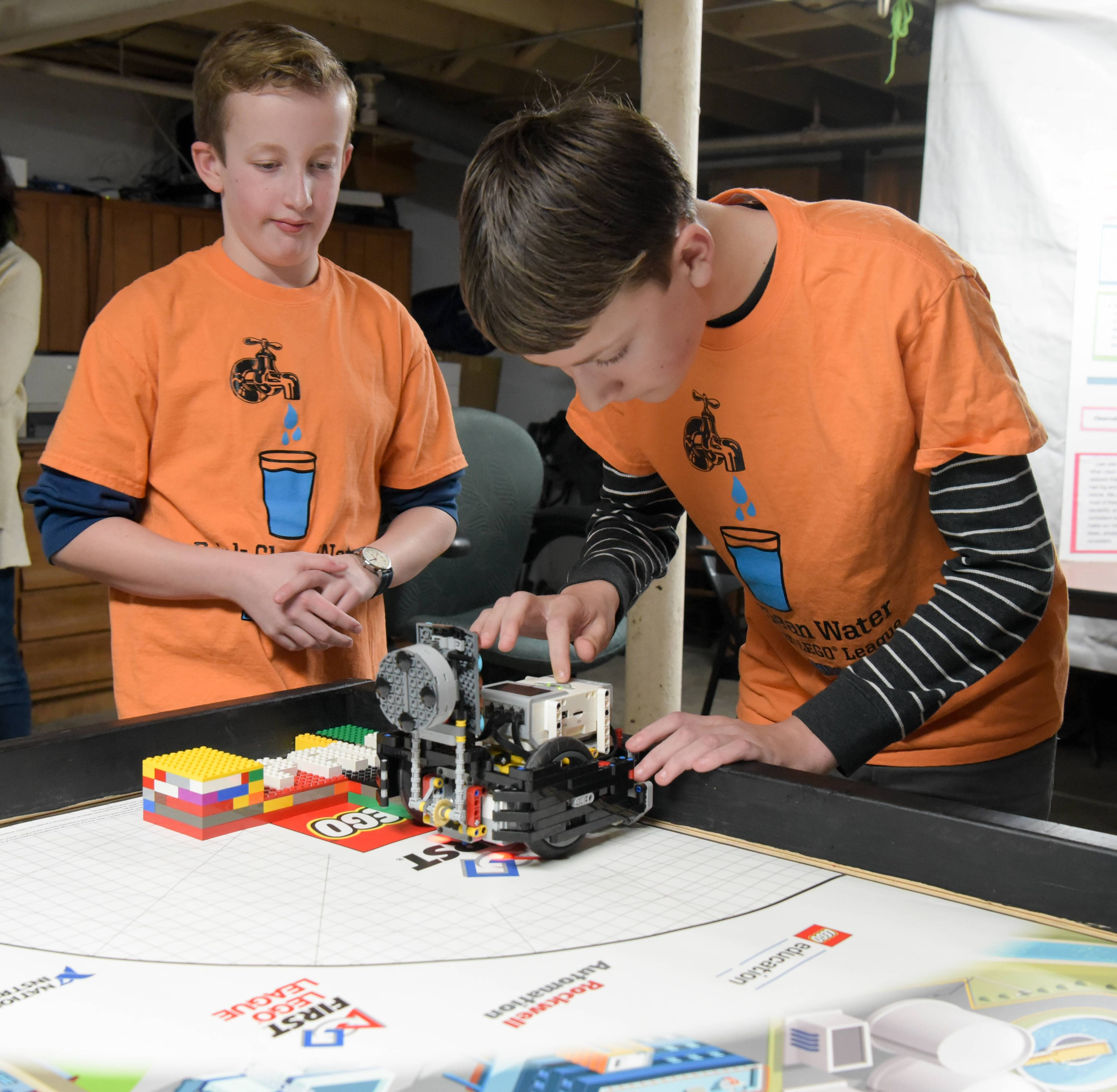 Sam Aldrich and Connor Shipley, of a Naperville robotics club called Park Addition Lego League, get the team's robot ready to run the course during a practice Wednesday for a state competition Sunday in Elgin.
