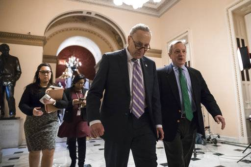 Senate Minority Leader Chuck Schumer, D-N.Y., left, walks with Sen. Dick Durbin, D-Ill., the minority whip, as lawmakers continue negotiating on a deal that would include a fix for the Deferred Action for Childhood Arrivals (DACA) program, at the Capitol in Washington, Thursday, Jan. 11, 2018.