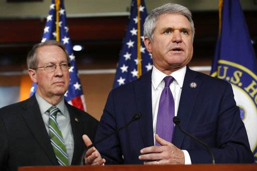 House Judiciary Committee Chairman Rep. Bob Goodlatte, R-Va., left, listens as House Homeland Security Committee Chairman Rep. Michael McCaul, R-Texas, speaks during a news conference on their immigration bill, Wednesday, Jan. 10, 2018, on Capitol Hill in Washington.