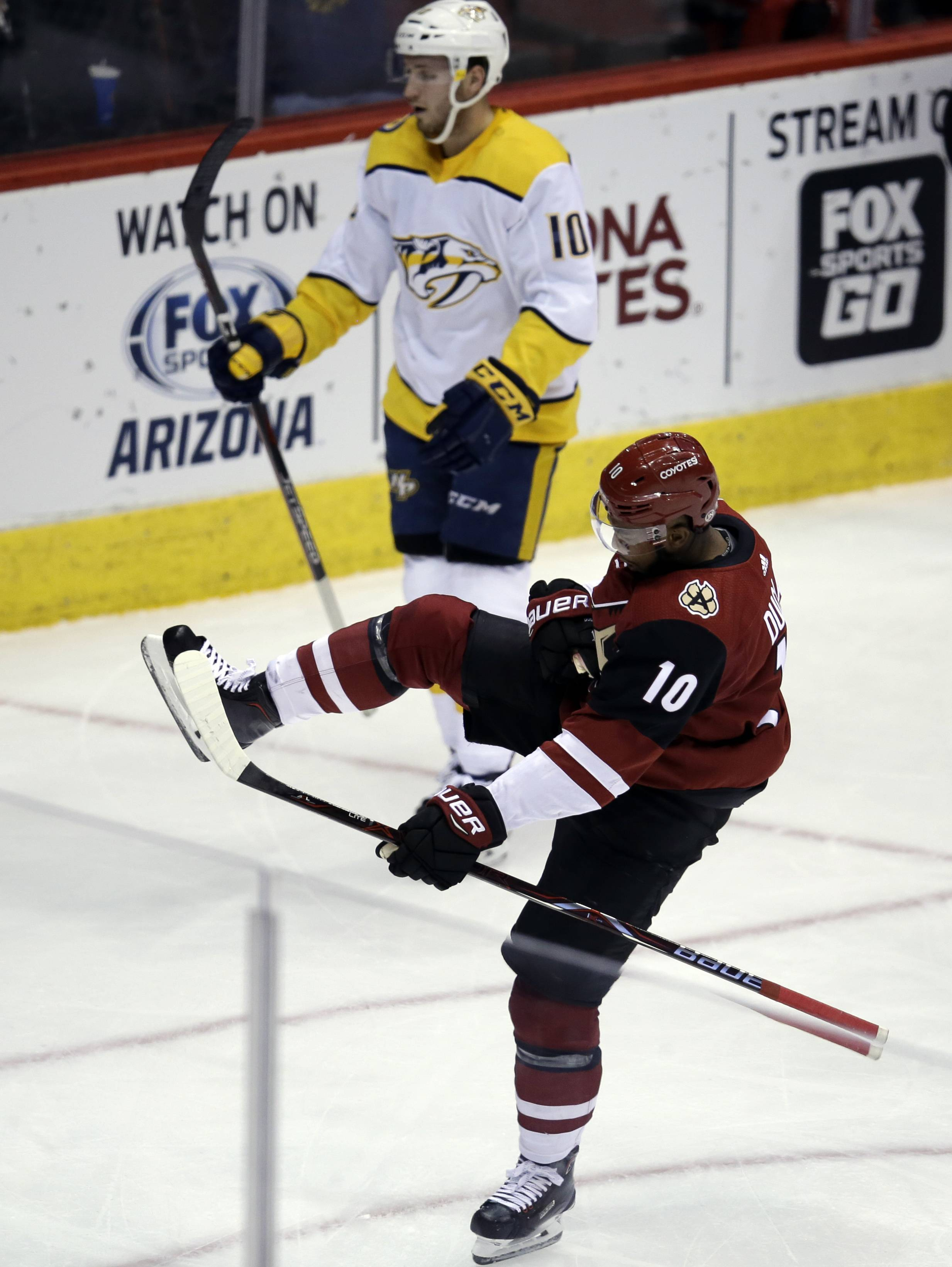 Arizona Coyotes left wing Anthony Duclair (10) celebrates after scoring a goal against the Nashville Predators during the second period during an NHL hockey game Thursday, Jan. 4, 2018, in Glendale, Ariz.