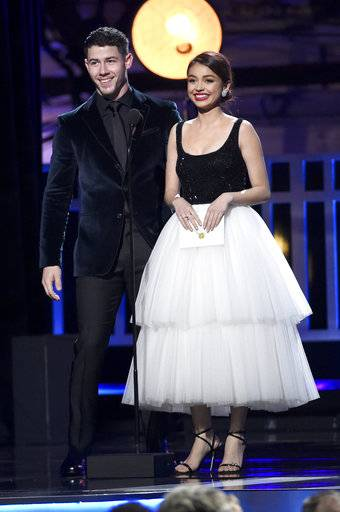 Nick Jonas, left, and Sarah Hyland present the award for best actor in a movie made for TV or limited series at the 23rd annual Critics' Choice Awards at the Barker Hangar on Thursday, Jan. 11, 2018, in Santa Monica, Calif. (Photo by Chris Pizzello/Invision/AP)
