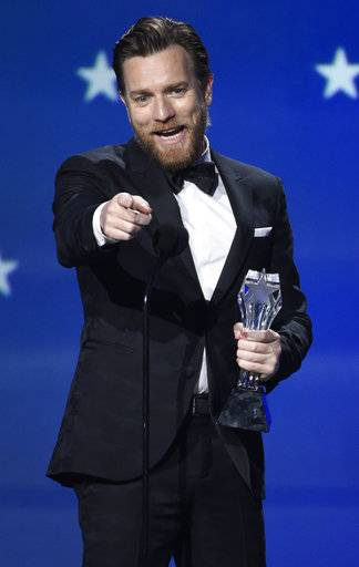 "Ewan McGregor accepts the award for best actor in a movie made for TV or limited series for ""Fargo"" at the 23rd annual Critics' Choice Awards at the Barker Hangar on Thursday, Jan. 11, 2018, in Santa Monica, Calif. (Photo by Chris Pizzello/Invision/AP)"