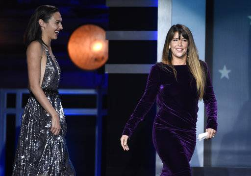 "Gal Gadot, left, and Patty Jenkins walk on stage to accept the award for best action movie for ""Wonder Woman"" at the 23rd annual Critics' Choice Awards at the Barker Hangar on Thursday, Jan. 11, 2018, in Santa Monica, Calif. (Photo by Chris Pizzello/Invision/AP)"