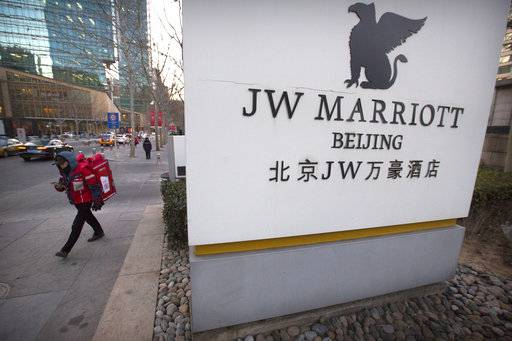 A deliveryman walks away from the entrance of a JW Marriott hotel in Beijing, Thursday, Jan. 11, 2018. The Marriot hotel chain apologized Thursday to China's government for referring to Tibet and self-ruled Taiwan as countries in a customer survey that news reports said Chinese police investigated as a possible crime.