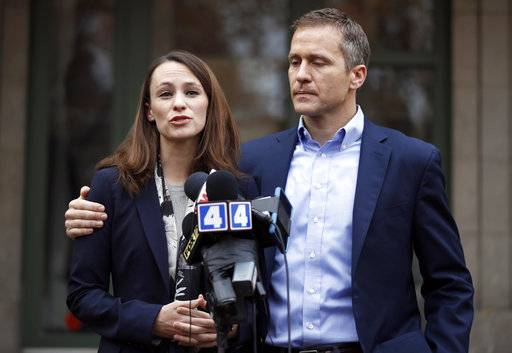 "FILE - In this Dec. 6, 2016, file photo, Missouri Gov.-elect Eric Greitens and his wife Sheena speak to the media in St. Louis after she had been robbed at gunpoint the day before. Responding to a news report that overshadowed his annual State of the State address Wednesday night, Jan. 10, 2018, the Republican governor acknowledged he's been ""unfaithful"" in his marriage but denied allegations that he blackmailed the woman to stay quiet. The couple released a statement late Wednesday after the report that he had a sexual relationship with his former hairdresser in 2015."