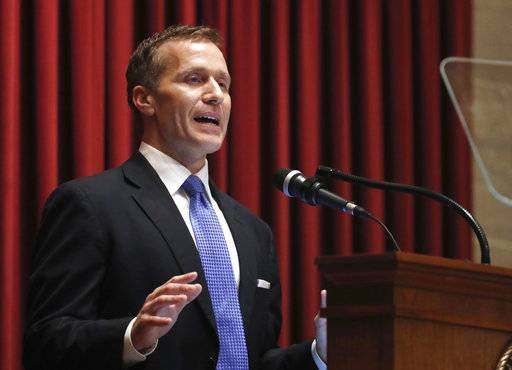 "FILE - In this Jan. 10, 2018, file photo, Missouri Gov. Eric Greitens delivers the annual State of the State address to a joint session of the House and Senate in Jefferson City, Mo. Responding to a news report that overshadowed his annual address, Greitens acknowledged he's been ""unfaithful"" in his marriage but denied allegations that he blackmailed the woman to stay quiet. The Republican governor and his wife released a statement late Wednesday, after a report that he had a sexual relationship with his former hairdresser in 2015."