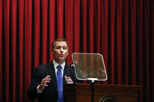 "FILE - In this Wednesday, Jan. 10, 2018 file photo, Missouri Gov. Eric Greitens delivers the annual State of the State address to a joint session of the House and Senate, in Jefferson City, Mo. Greitens acknowledges he was ""unfaithful"" in his marriage but denies allegations that he blackmailed the woman he had an extramarital affair with in 2015 to stay quiet. The Republican governor and his wife released a statement Wednesday night."