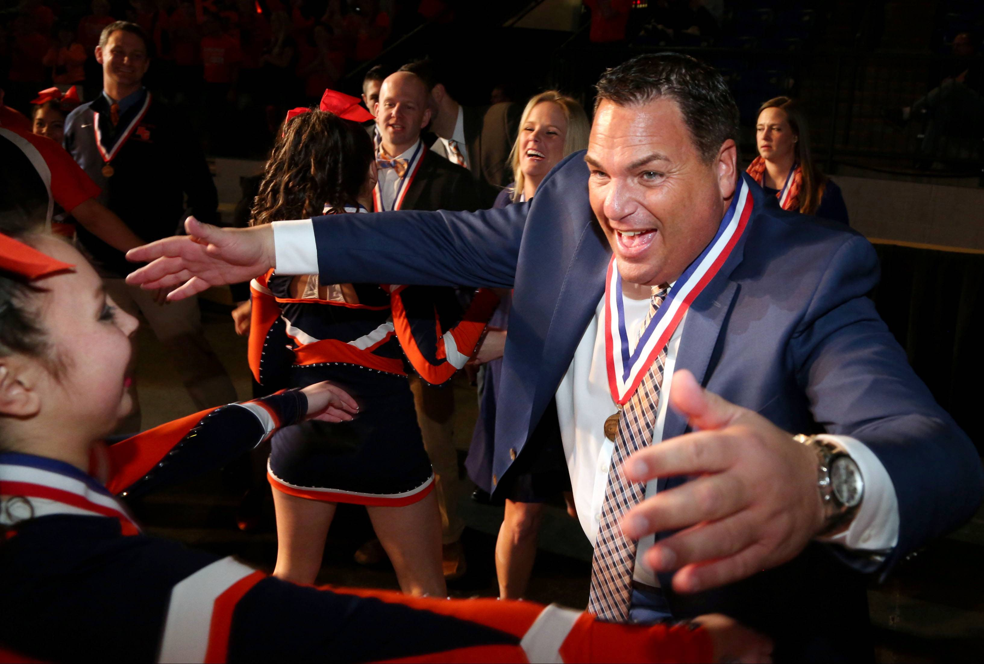 Buffalo Grove High School cheerleading coach Jeff Siegal celebrates in 2016 after his team won the state championship. Siegal was named coach of the year by a national organization this week.