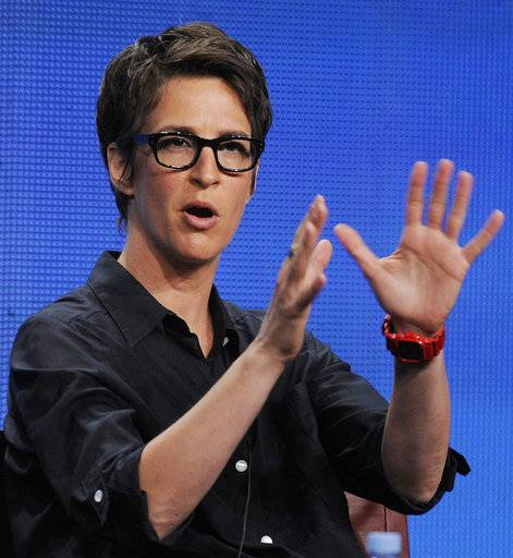 "File-This Aug. 2, 2011, file photo shows Rachel Maddow, host of ""The Rachel Maddow Show"" on MSNBC, taking part in a panel discussion at the NBC Universal summer press tour, in Beverly Hills, Calif.  Donald Trump ignored it when a reporter asked him at the White House on Friday whether he was a racist. But there's no getting around that more people in the media are willing to use that label. The president's reference to African ""shithole"" countries and reported resistance to more immigration from Haiti felt like a tipping point in the number of people willing to call HIM a racist, rather than say his words or actions exhibited racism. The label came from different places, Comedy Central's Trevor Noah, MSNBC's  Maddow, CNN's Don Lemon and Sunny Hostin of ""The View."""