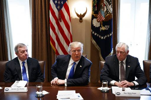 Sen. Dick Durbin, D-Ill., left, and Rep. Steny Hoyer, D-Md. listen as President Donald Trump speaks during a meeting with lawmakers on immigration policy in the Cabinet Room of the White House, Tuesday, Jan. 9, 2018, in Washington.