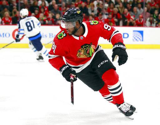 Chicago Blackhawks left wing Anthony Duclair (91) takes the ice for the first time with the team, against the Winnipeg Jets during the first period of an NHL hockey game Friday, Jan. 12, 2018, in Chicago.