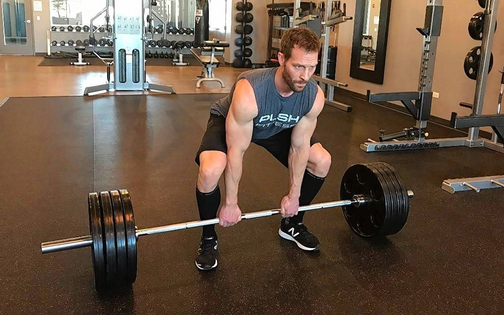 Josh Steckler demonstrates proper form for a barbell dead lift.