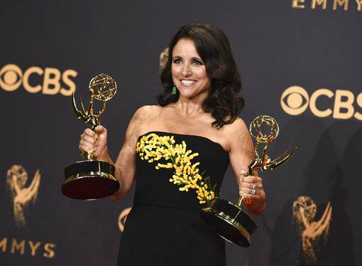 "FILE - In this Sunday, Sept. 17, 2017 file photo, Julia Louis-Dreyfus poses in the press room with her awards for outstanding lead actress in a comedy series and outstanding comedy series for ""Veep"" at the 69th Primetime Emmy Awards at the Microsoft Theater in Los Angeles. On Friday, Jan. 12, 2018, Julia Louis-Dreyfus marked the end of chemotherapy by posting a video on Instagram of her grown sons lip-syncing to Michael Jackson's ""Beat It.� (Photo by Jordan Strauss/Invision/AP)"