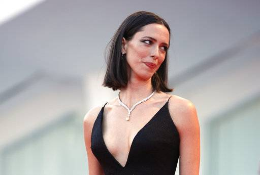 "FILE - In this Sept. 5, 2017 file photo, actress Rebecca Hall poses for photographers at the premiere of the film 'mother!' at the 74th edition of the Venice Film Festival in Venice, Italy, Hall says she's donating her salary from the latest Woody Allen film to Time's Up. Hall said on Instagram she was hired for Allen's ""A Rainy Day in New York� but is ""profoundly sorry� and ""regrets� her decision to work with the filmmaker. She said Friday, Jan. 12, 2018, she reconsidered the job after reviewing molestation accusations by Allen's daughter Dylan Farrow. (AP Photo/Domenico Stinellis, File)"