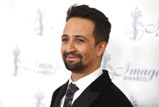 "FILE - In this Aug. 18, 2017 file photo, Lin-Manuel Miranda arrives at the 32nd annual Imagen Awards at the Beverly Wilshire Hotel in Beverly Hills, Calif. After word got out earlier this week that Coogan's, a famed New York City pub, would be closing because of a rent increase, supporters including the ""Hamilton� creator rallied to save the local landmark. The New York Times reports more than 15,000 people signed a petition. On Friday, Miranda, Jan. 12, 2018, was among those celebrating at Coogan's after the owners settled on a new lease with the property owners. Miranda said he's been visiting the restaurant since he was a boy. Lease terms were not disclosed. (Photo by Richard Shotwell/Invision/AP)"