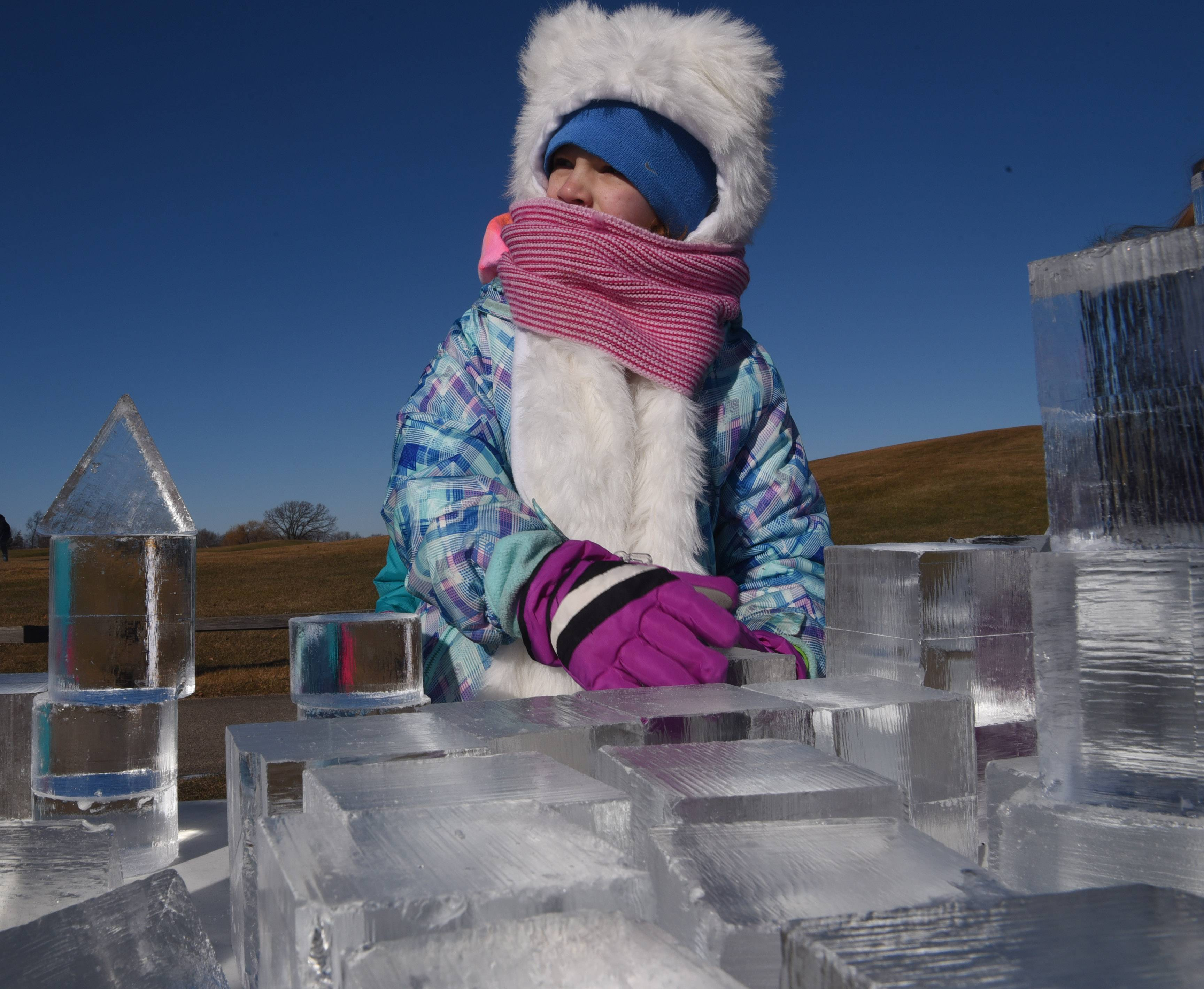 Olivia Wood, 8, of Grayslake stacks blocks of ice during Frosty Fest at Bittersweet Golf Club in Gurnee Saturday.
