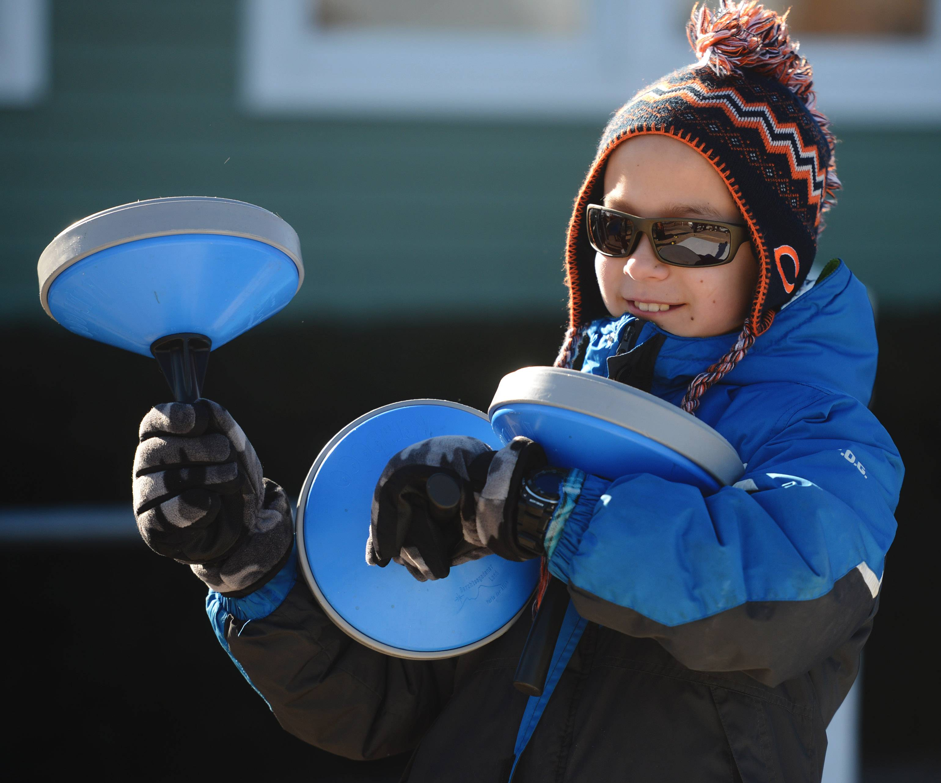 Zachary Kowalski, 11, of Gurnee gets ready for another curling match during Frosty Fest at Bittersweet Golf Club in Gurnee Saturday.