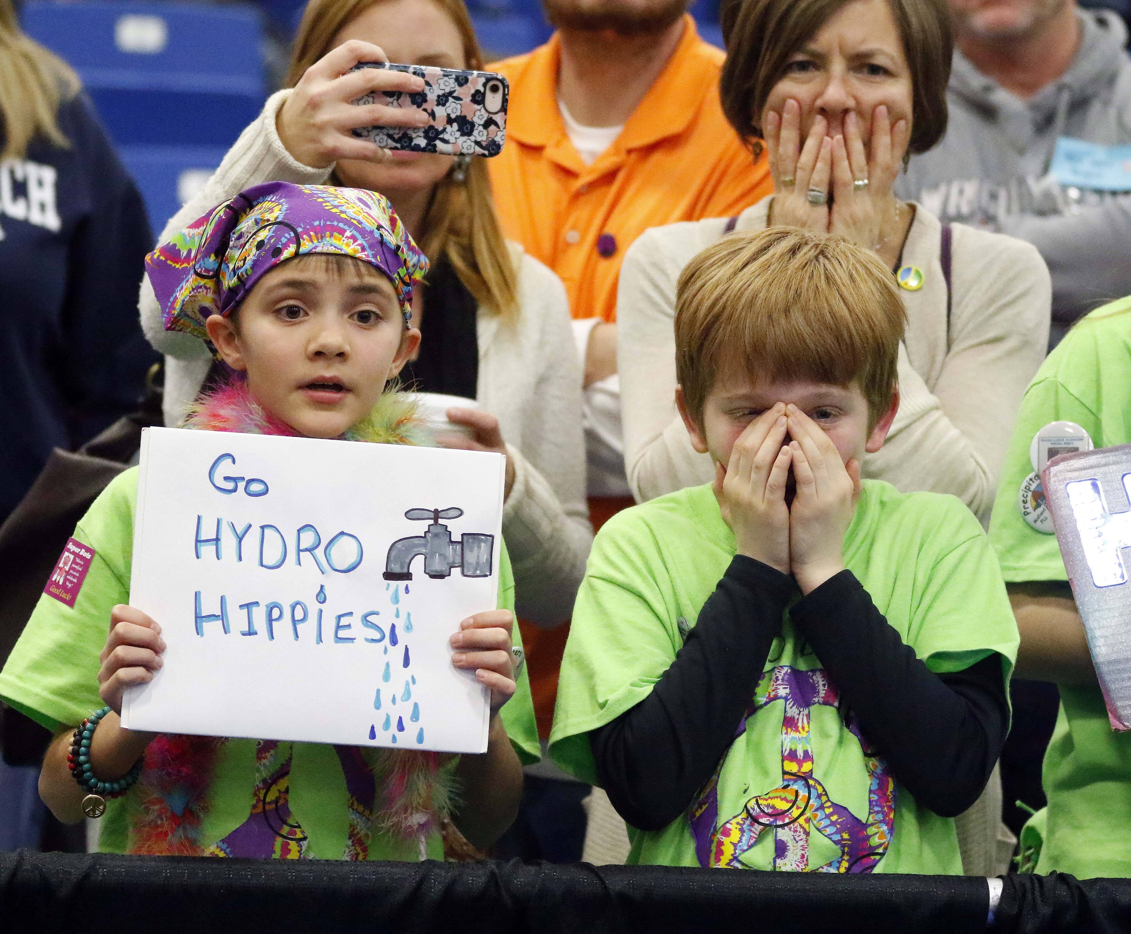 Malaika Parpart and William Madigan, both 11 and from Woodstock, cheer on their team, the Hydro Hippies, Saturday during the First Lego League Tournament at Elgin Community College where 50 teams from across the state competed.