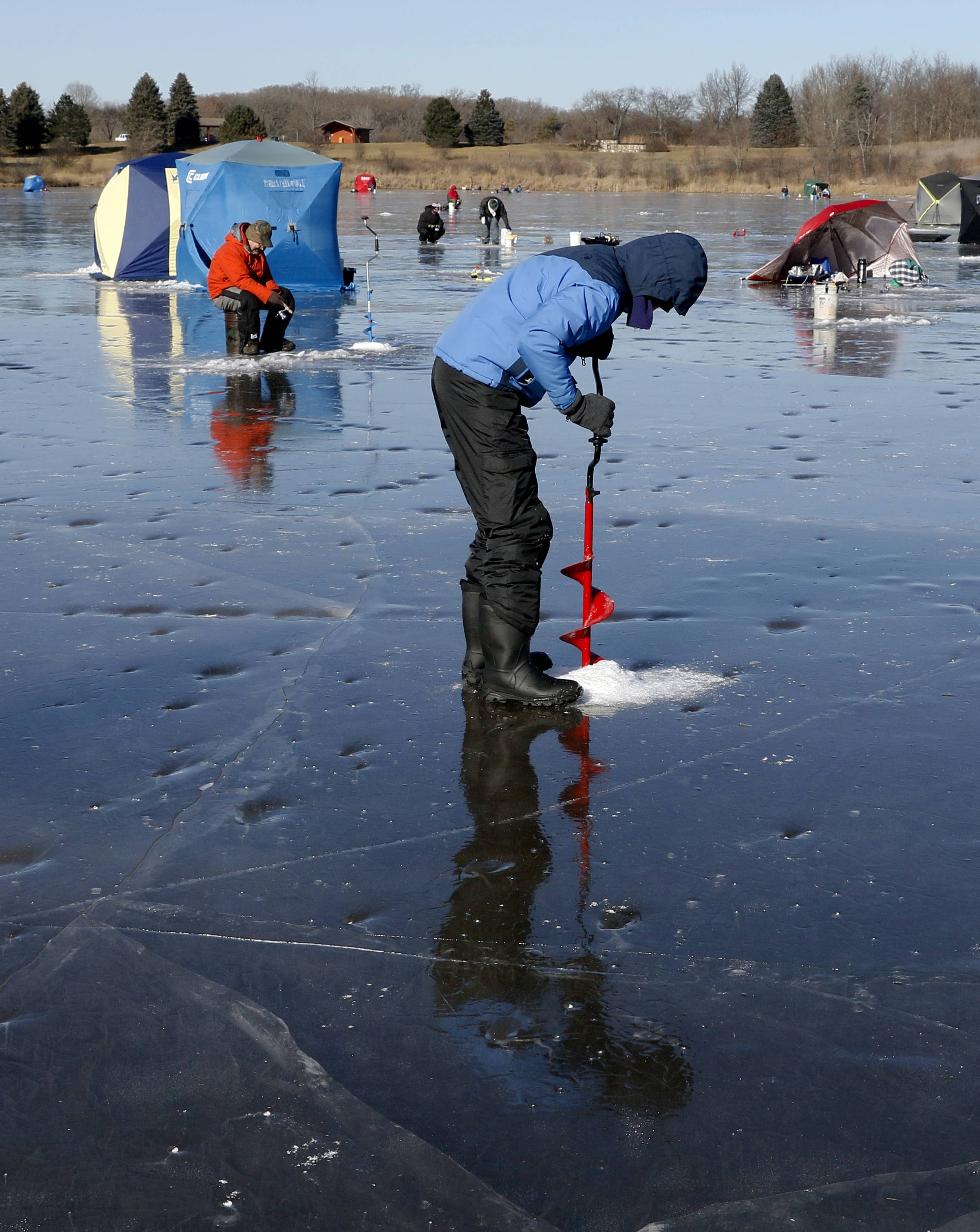 Paul Skaluba of Naperville bores a hole during the DuPage Forest Preserve District's Hard Water Classic ice fishing tournament at Silver Lake in the Blackwell Forest Preserve. Skaluba used a sucker fish as bait hoping to catch a Northern Pike.