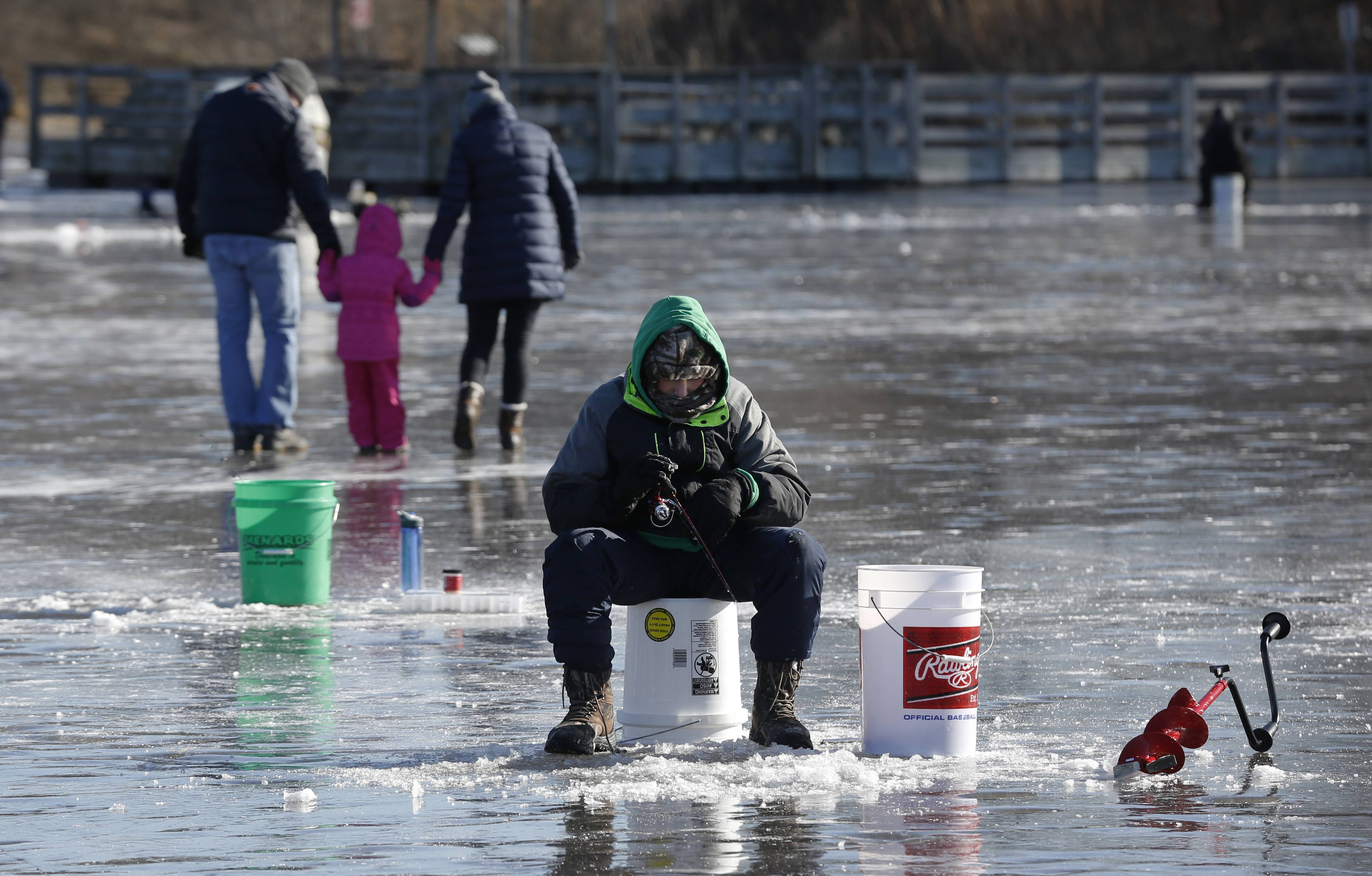 Jake Mantovani, 12, of Naperville patiently waits for a bite during the DuPage Forest Preserve District's Hard Water Classic ice fishing tournament at Silver Lake in the Blackwell Forest Preserve.