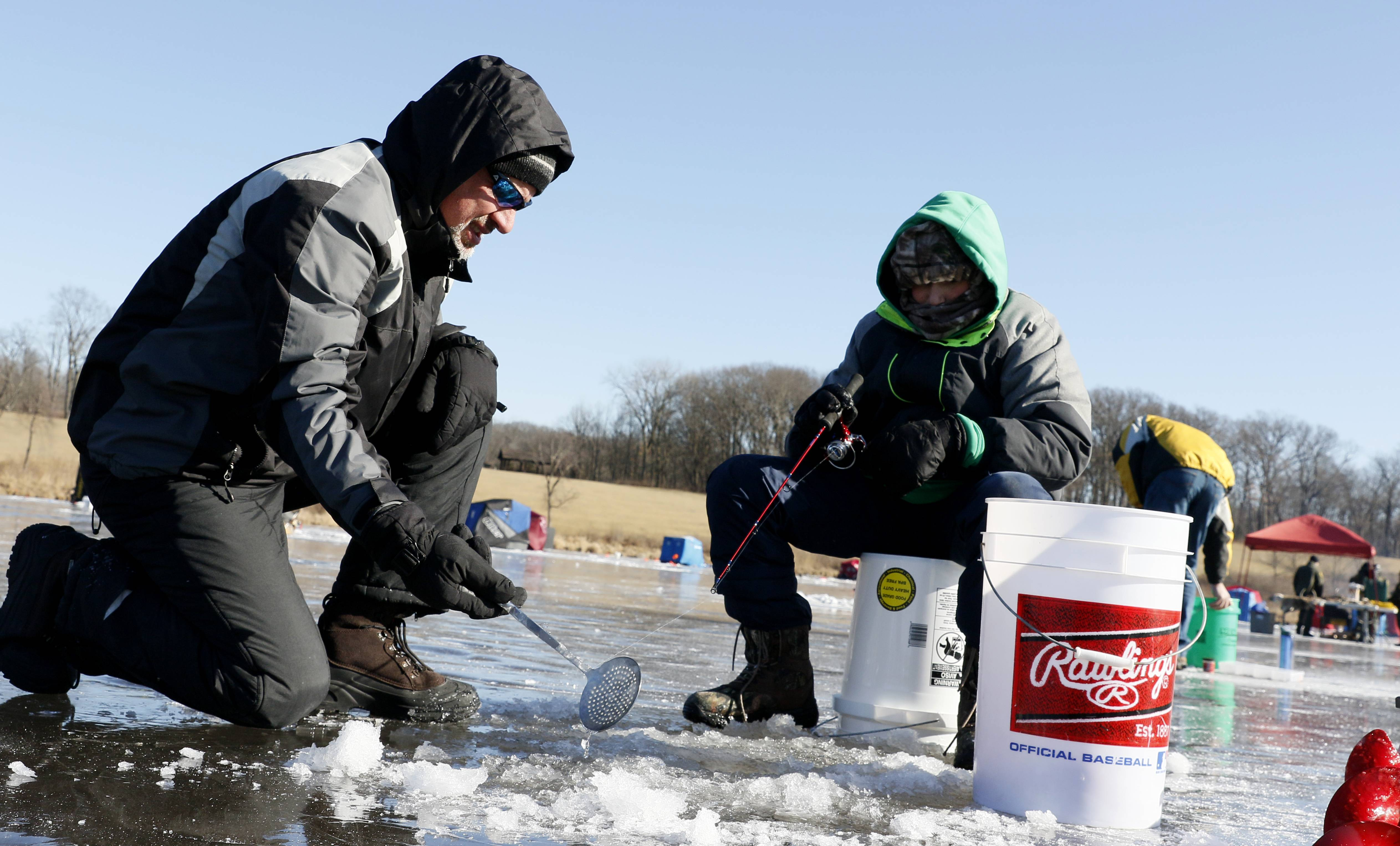 Paul Mantovani, left, and his son Jake, 12, of Naperville patiently wait for a bite during the DuPage Forest Preserve District's Hard Water Classic ice fishing tournament at Silver Lake in the Blackwell Forest Preserve.