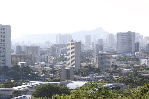 Diamond Head, an extinct volcanic crater, and high-rises are seen in Honolulu on Saturday, Jan. 13, 2018. A push alert that warned of an incoming ballistic missile to Hawaii and sent residents into a full-blown panic was a mistake, state emergency officials said.