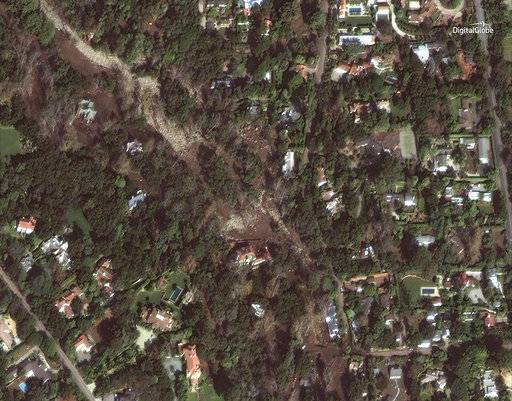This Jan. 11, 2018 satellite image released by DigitalGlobe News Bureau shows an area of homes after storms caused mudslides and flooding in Montecito, Calif. The number of missing after a California mudslide has fluctuated wildly, due to shifting definitions, the inherent uncertainty that follows a natural disaster, and just plain human error. (DigitalGlobe News Bureau via AP)