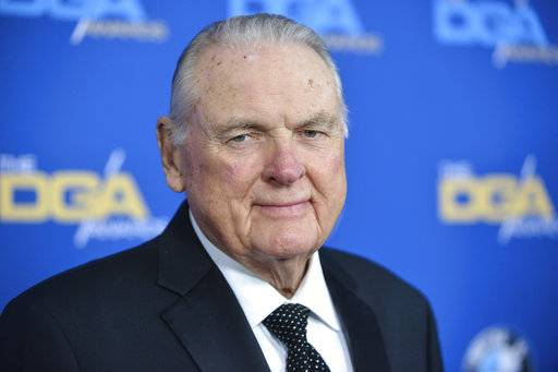FILE - In this Jan. 25, 2014, file photo, Keith Jackson arrives at 66th Annual DGA Awards Dinner at the Hyatt Regency Century Plaza Hotel in Los Angeles. Jackson, the down-home voice of college football during more than five decades as a broadcaster, died Friday, Jan. 12, 2018. He was 89.  (Photo by Richard Shotwell Invision/AP, File)